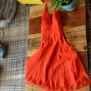 Orange Marilyn Monroe style cocktail length dress